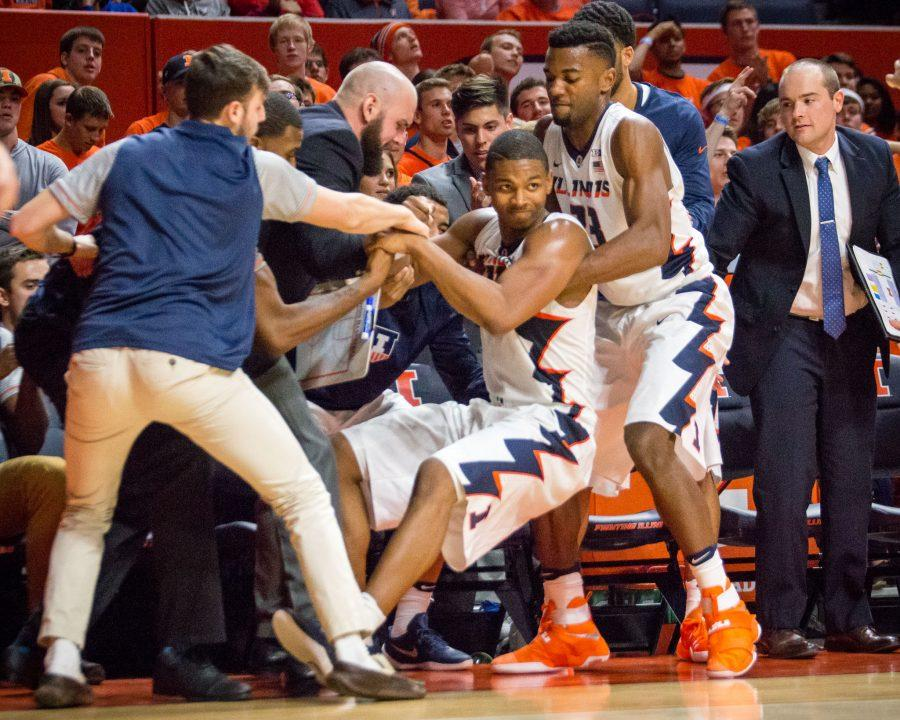 Illinois' Malcolm Hill (center) receives help up after being fouled while shooting a three during the game against Southeast Missouri at State Farm Center on Friday, November 11. The Illini won 81-62.
