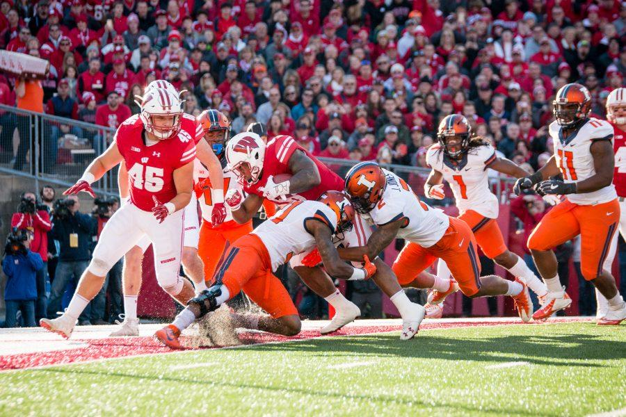 Wisconsin running back Corey Clement (6) runs through the Illinois defense for a touchdown during the first half of the game against Wisconsin at Camp Randall on Saturday, November 12. The Illini are losing 31-3 at half after the first half.