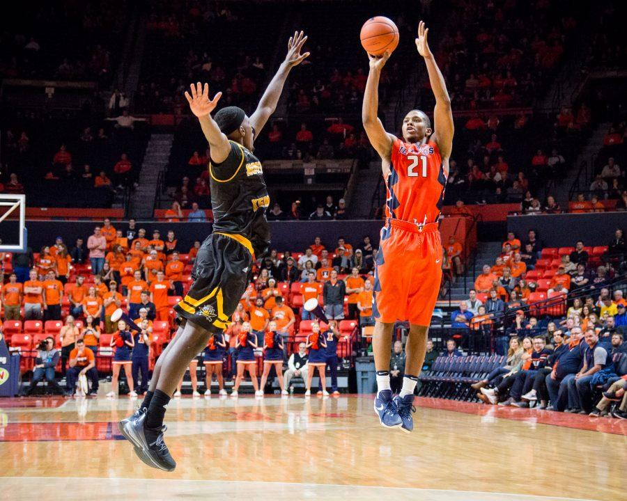 Illinois' Malcolm Hill (21) shoots a three during the game against Northern Kentucky at State Farm Center on Sunday, November 13. Hill scored a career high of 40 points and the Illini won 79-64.