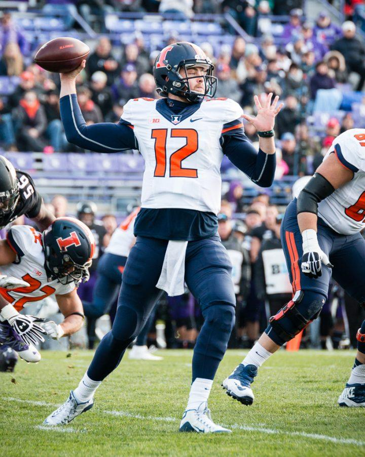 Illinois quarterback Wes Lunt (12) passes the ball during the first half of the game against Northwestern at Ryan Field on Saturday, November 26. The Illini are down 21-14 at halftime.