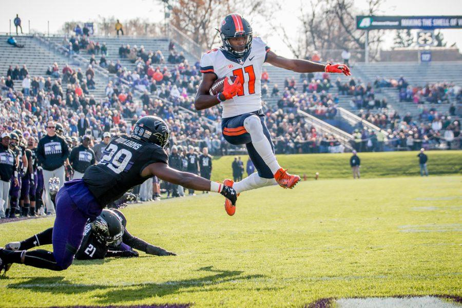 Illinois+wide+receiver+Malik+Turner+%2811%29+jumps+over+a+tackle+on+his+way+to+the+end+zone+during+the+first+half+of+the+game+against+Northwestern+at+Ryan+Field+on+Saturday%2C+November+26.+The+Illini+are+down+21-14+at+halftime.