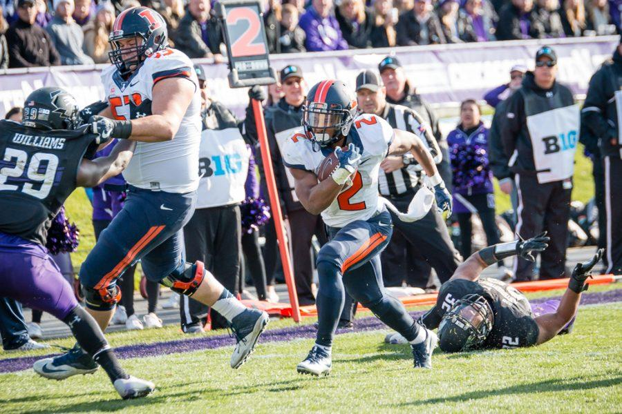 Illinois running back Reggie Corbin (2) runs down the sideline for a touchdown during the first half of the game against Northwestern at Ryan Field on Saturday, November 26. The Illini are down 21-14 at halftime.