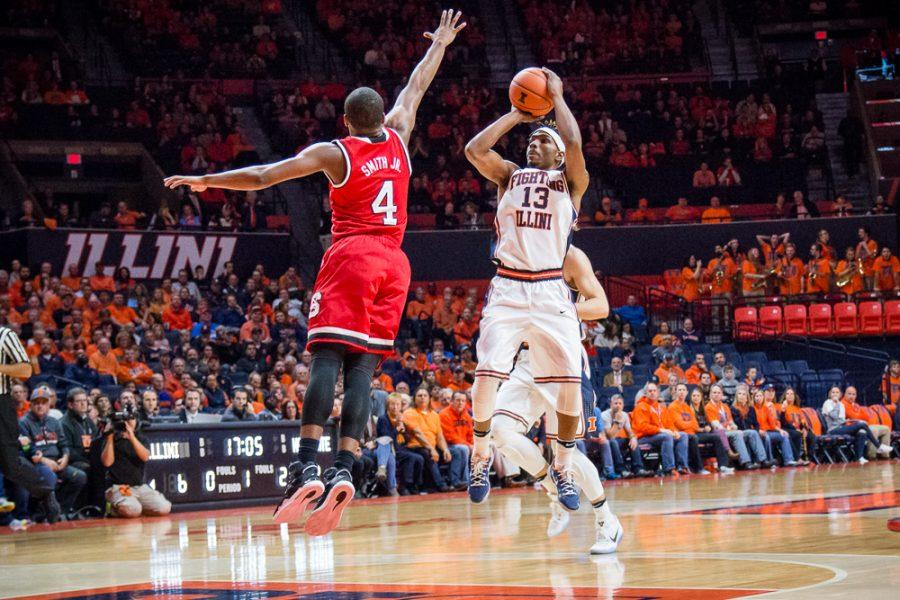 Illinois' Tracy Abrams (13) rises up for a short jumper during the game against North Carolina State at State Farm Center on Tuesday, November 29. The Illini won 88-74.