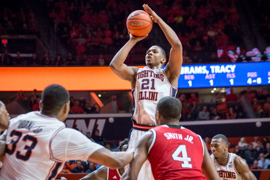 Illinois' Malcolm Hill (21) rises up for a jump shot during the game against North Carolina State at State Farm Center on Tuesday, November 29. The Illini won 88-74.