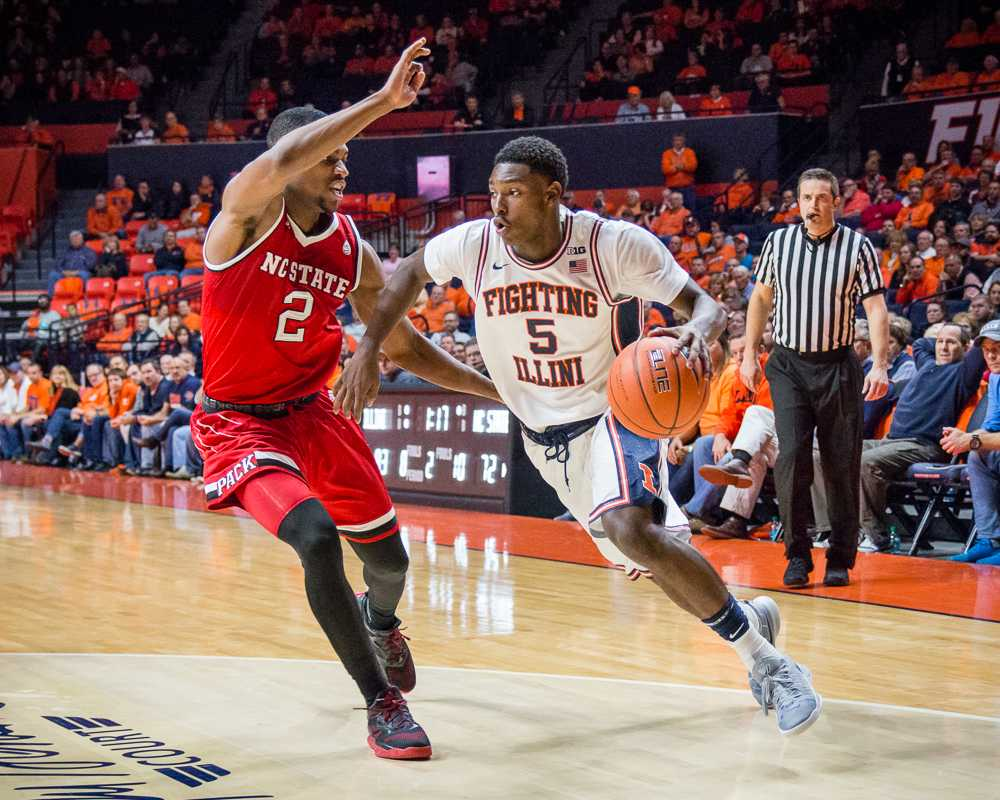 Illinois' Jalen Coleman-Lands (5) drives to the basket during the game against North Carolina State at State Farm Center on Nov. 29. The Illini won 88-74.