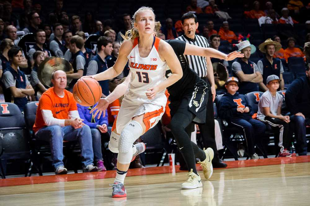 Illinois' Petra Holešínská (13) dribbles around her defender during the game against Wake Forest at State Farm Center on Wednesday. The Illini lost 79-70.