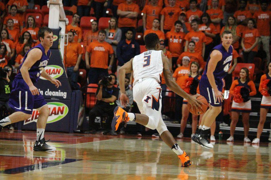 Te'Jon Lucas (3) dribbles the ball towards McKendree's basket in the game against McKendree on Tuesday. The Illini won 112-65.