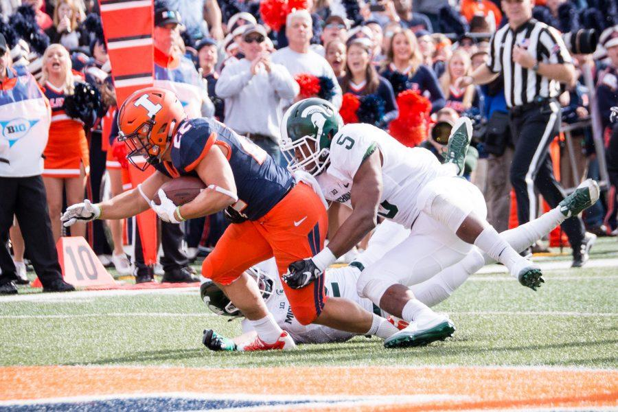 Illinois running back Kendrick Foster (22) reaches towards the end zone for a touchdown during the first half of game against Michigan State at Memorial Stadium on Saturday, November 5. The Illini lead 7-6 at halftime.
