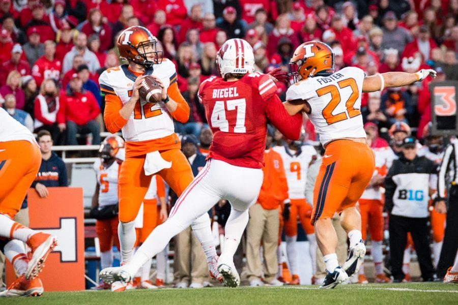 Illinois quarterback Wes Lunt (12) looks to pass the ball during the game against Wisconsin at Camp Randall on Saturday, November 12. The Illini lost 48-3.