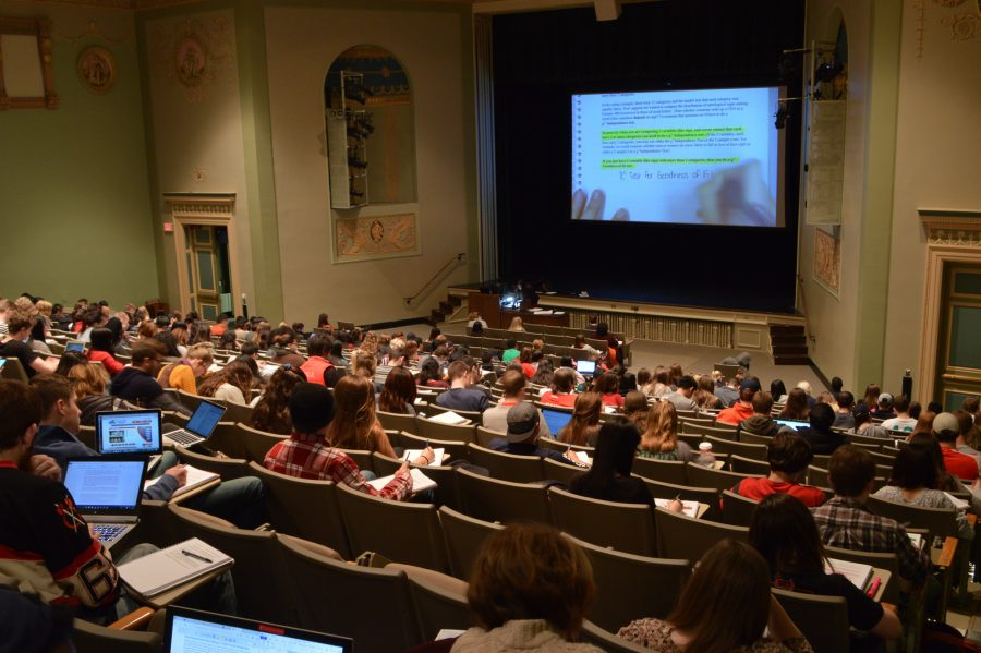 Statistics 100 students listen to newly hired instructor, Karle Laska, speak about the final few pages in the course manual on Dec 8, 2015. Statistics 100 is a popular course for incoming freshman transitioning into the academic pressures of the University.