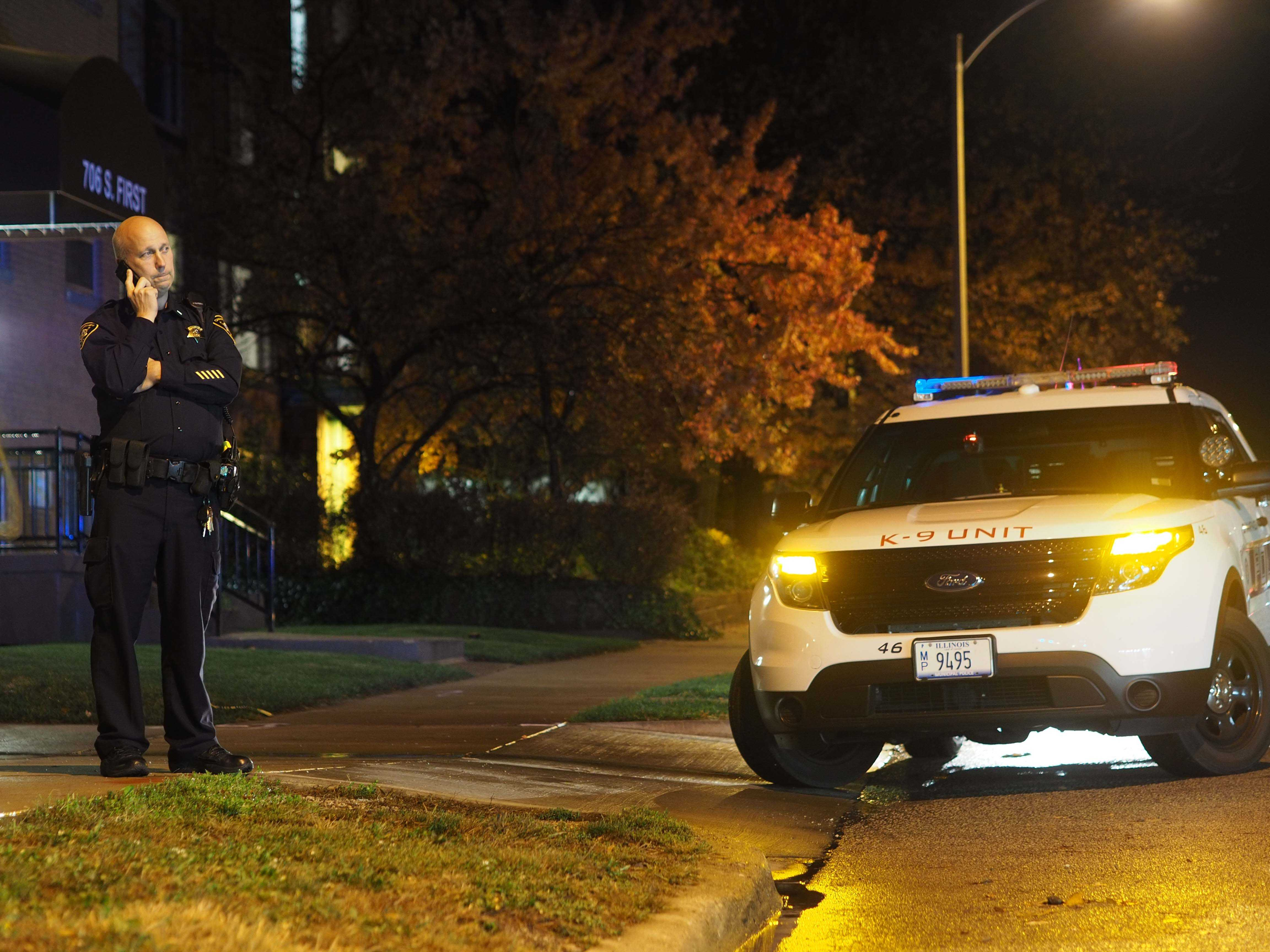Police officer patrols First Street after a campus town shooting on Wednesday night.