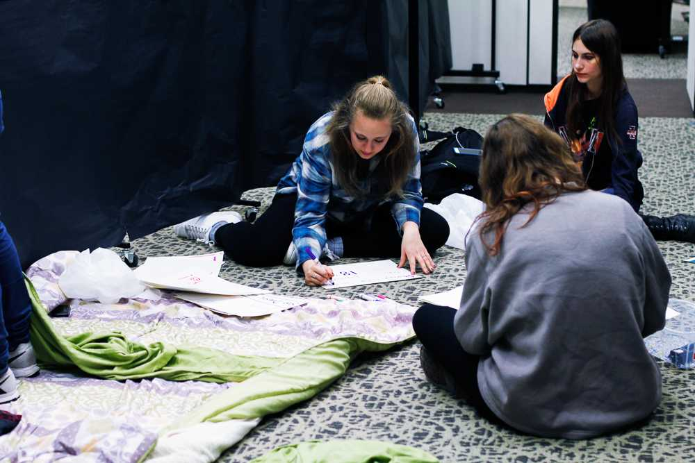 Students making preparations for the Tunnel of Oppression event on the second floor of the Ikenberry Commons on Nov. 13.