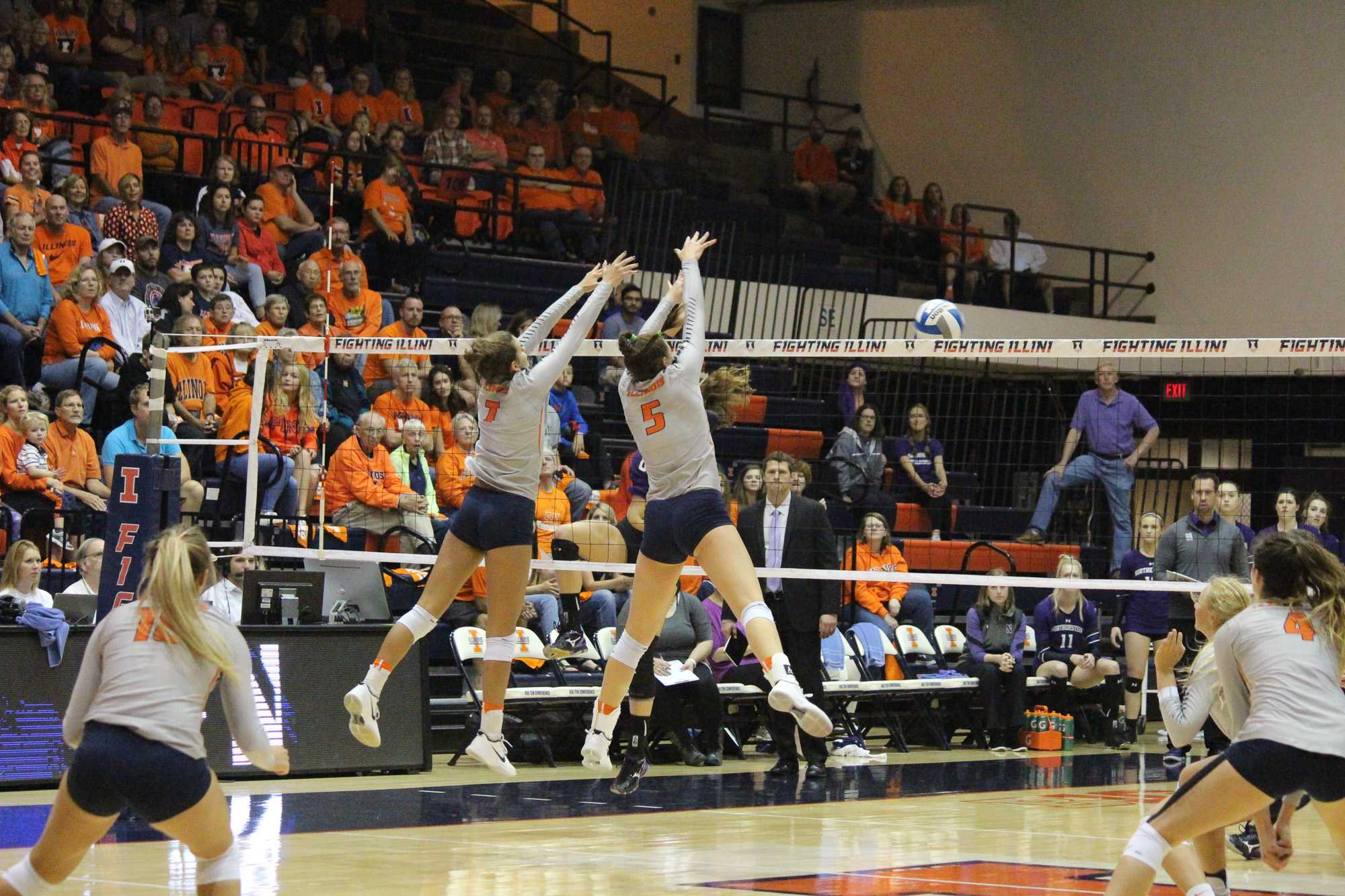 Jacqueline Quade (7) and Ali Bastianelli (5) jump up together to block the spike from Northwestern at Huff Hall on Oct. 15, 2016. Illini beat Northwestern 3-0.