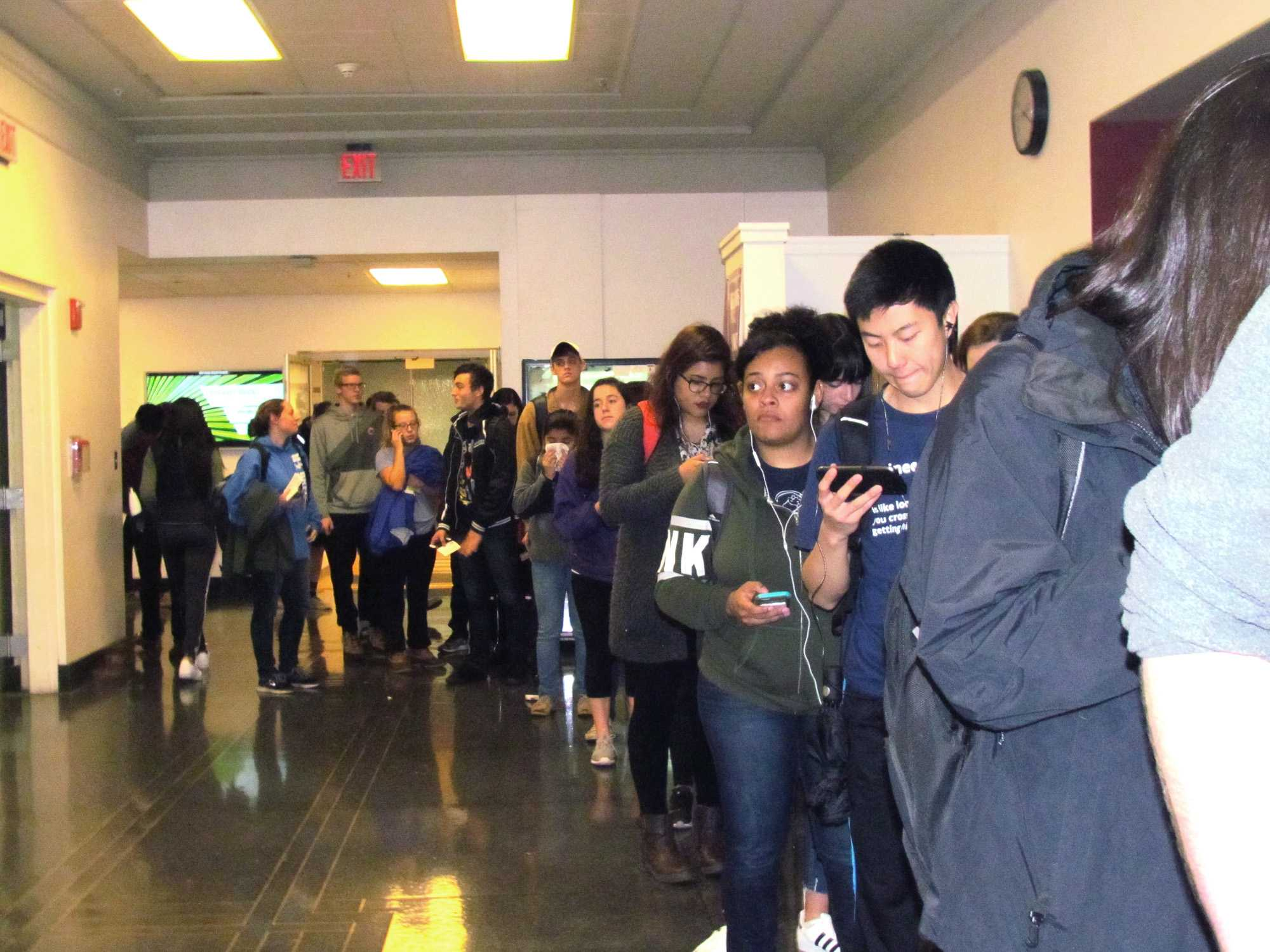 Students lineup at the polls in the Union basement for voting in the 2016 election.