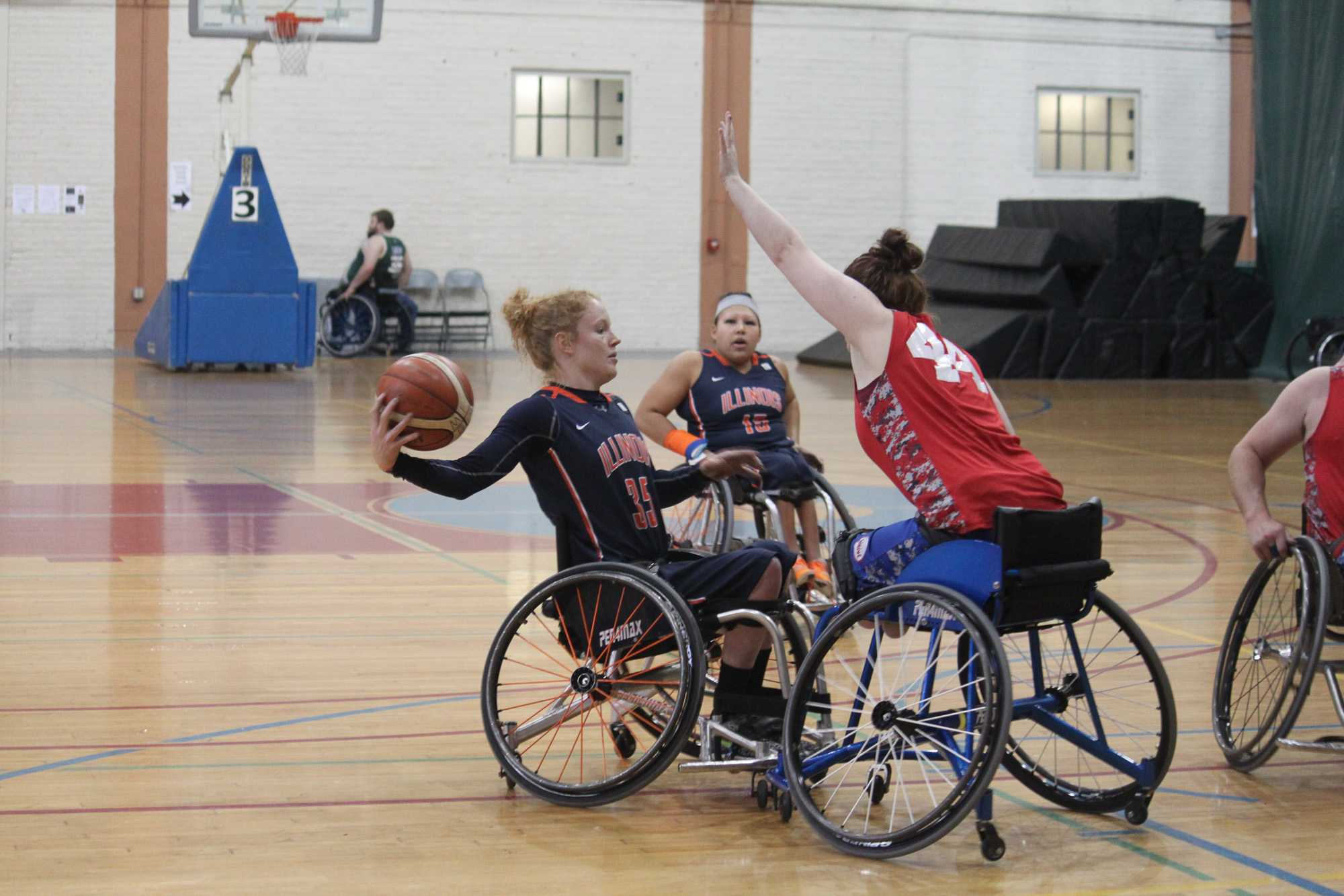 Grad student and captain Shelby Gruss looks to pass over threw the hands of the Mary Free Bed Rollin Drive defenders. Rollin Drive went on to defeat the Illinois women's wheelchair basketball team in the first round of the 2nd City Showdown's tournament in Chicago from Nov. 12-13.