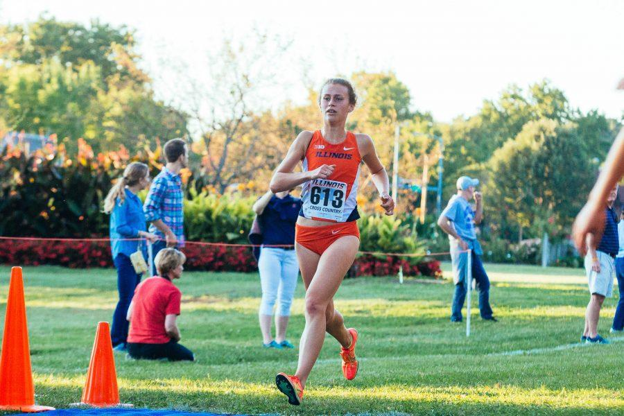 Audrey Blazek crossing the finish line during the women's cross-coutry Illini Challenge. The challenge was held at the UI Arboretum on Friday, September 2, 2016.