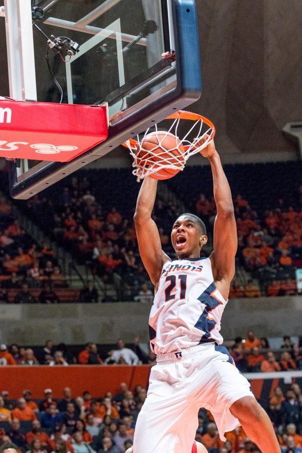 Illinois' Malcolm Hill throws down a two-handed dunk during the game against Rutgers at the State Farm Center on February 17. The Illini won 82-66.