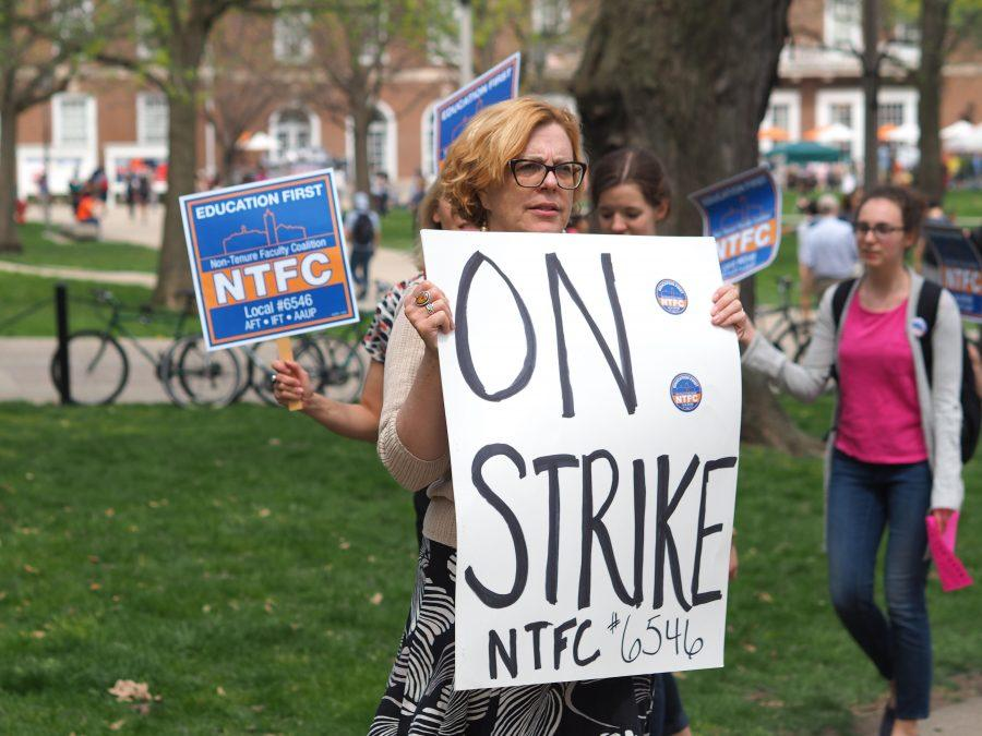 Students and faculty alike are found outside supporting the NTFC strikes outside of the English Building in Urbana, IL on Tuesday.