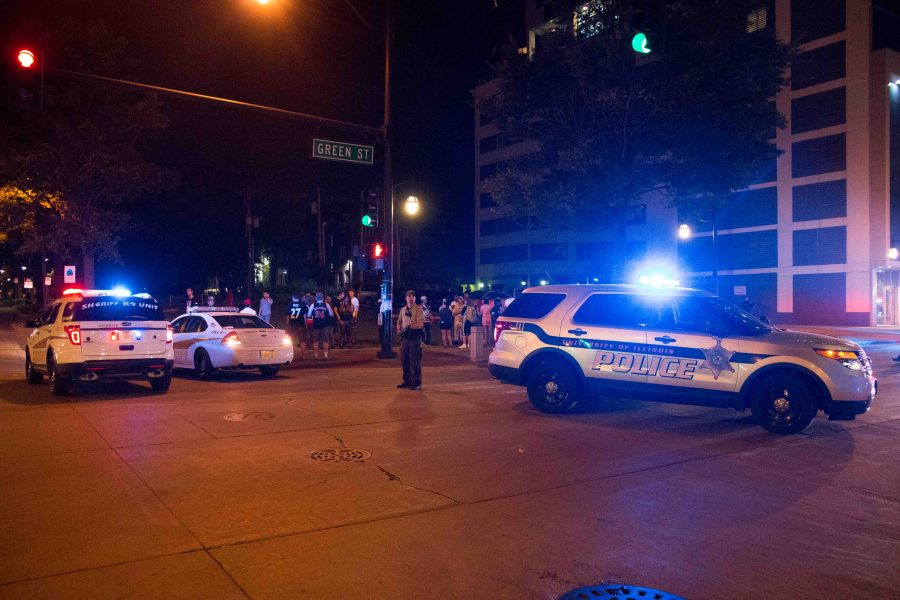 Police cars are parked at the intersection of Green and Fourth Street after a shooting that took place early Sunday morning.