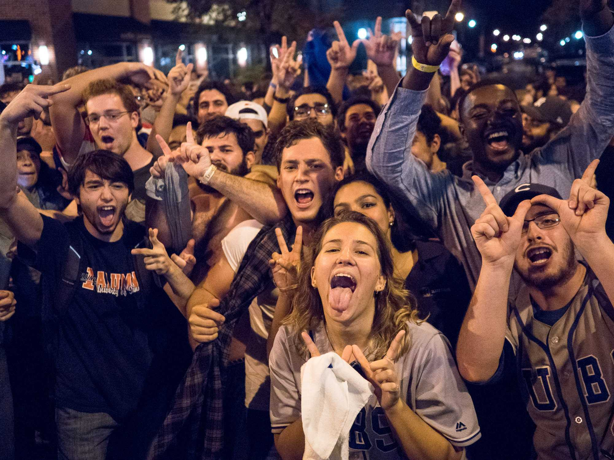 Students celebrate after the Cubs win Game 7 of the 2016 World Series against the Cleveland Indians on Wednesday, November 2 on Green Street at the University of Illinois at Urbana- Champaign.
