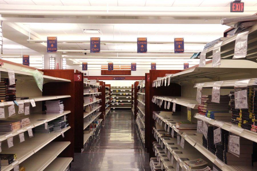Aisles of textbook in the lower level of Illini Bookstore on Sunday, Dec 4, 2016.