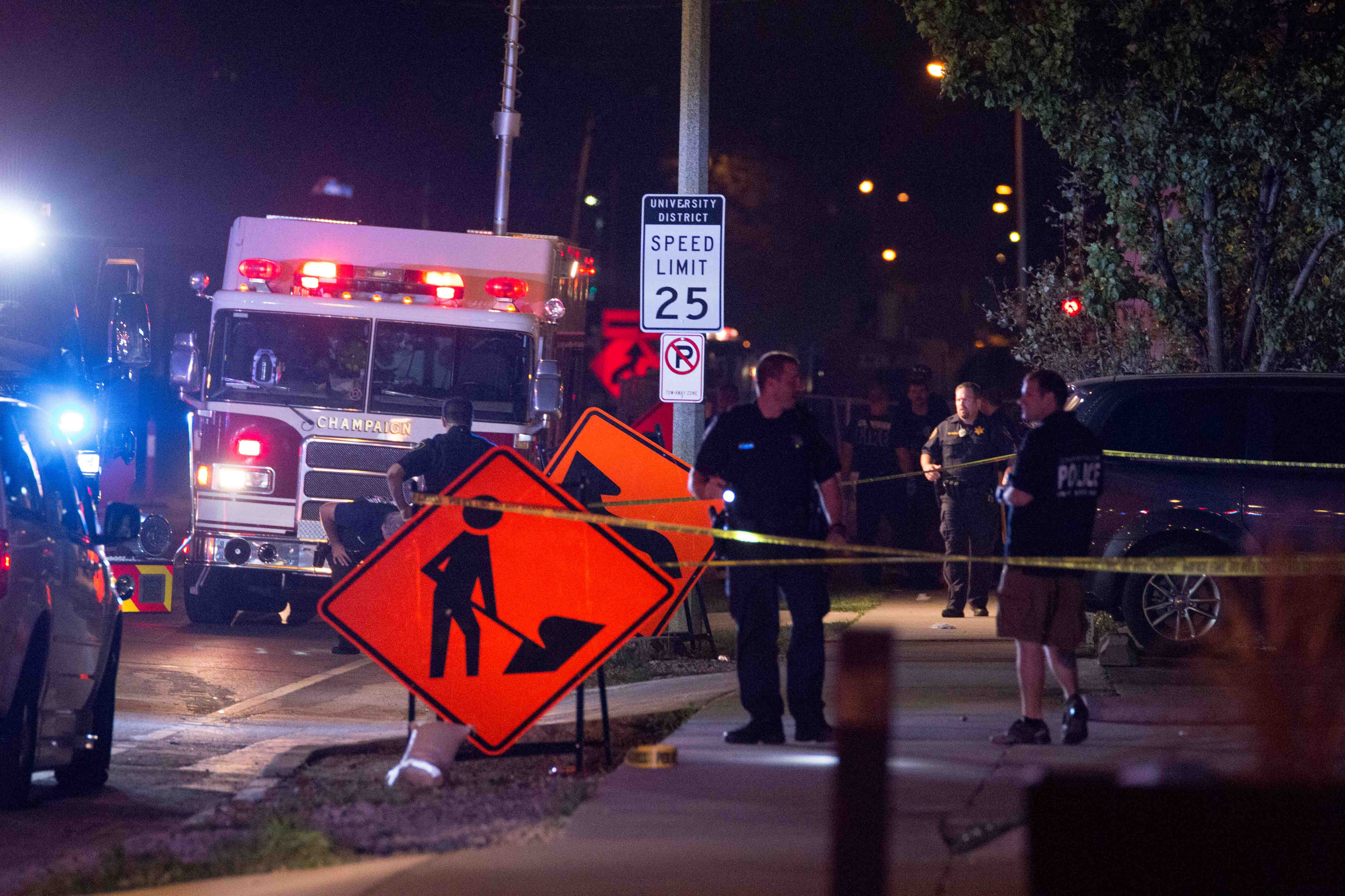 Police officers investigate what happened after a shooting that took place.