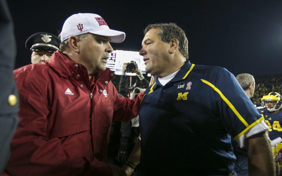 Indiana+head+coach+Kevin+Wilson+congratulates+Michigan+head+coach+Brady+Hoke%2C+right%2C+after+a+63-47+Michigan+win+at+Michigan+Stadium+in+Ann+Arbor%2C+Michigan%2C+on+Saturday%2C+October+19%2C+2013.+%28Jarrad+Henderson%2FDetroit+Free+Press%2FMCT%29