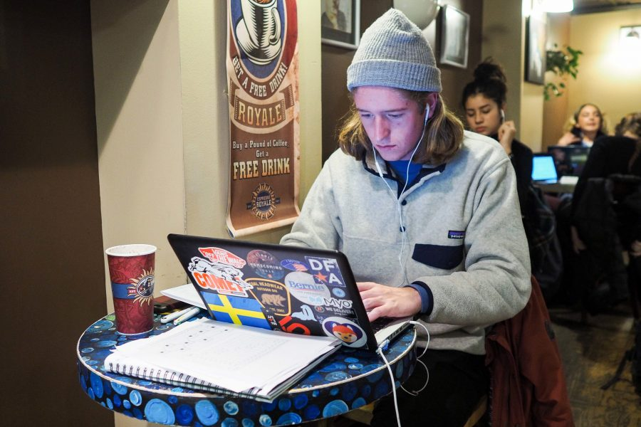 Isak Massman, junior, enjoys Espresso Royale's atmostphere while preparing for finals.