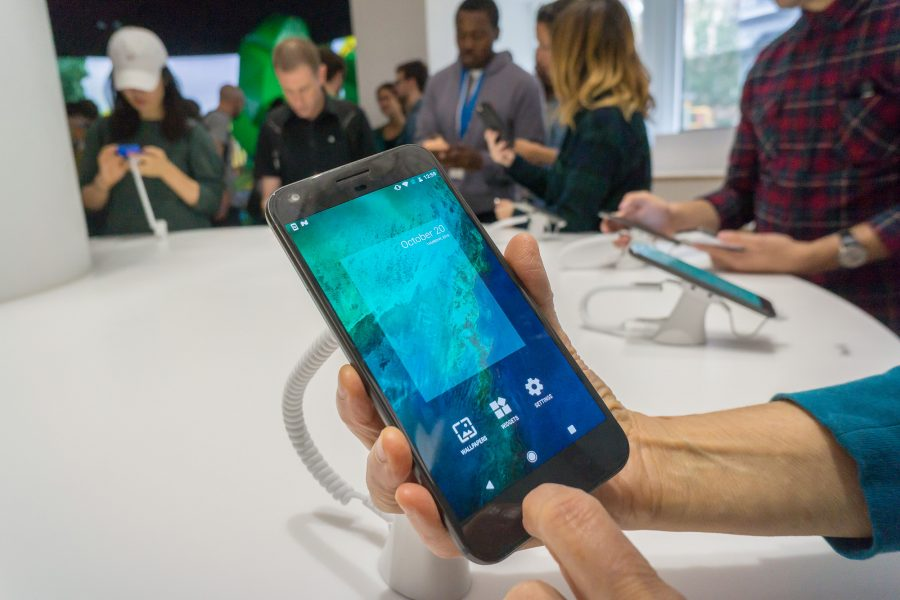 Visitors try out the new Pixel smartphones in the Google store in the Soho neighborhood of New York on its grand opening day, Thursday, October 20, 2016. The store displays a variety of products from Google besides the new Pixel smartphones. Excited customers cannot buy the products at the store and have to order them online. (Richard B. Levine/Sipa USA/TNS)