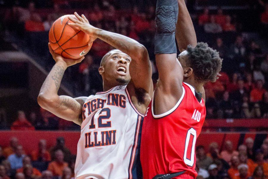 Illinois%27+Leron+Black+%2812%29+goes+up+for+a+layup+during+the+game+against+North+Carolina+State+at+State+Farm+Center+on+Tuesday%2C+November+29.+The+Illini+won+88-74.