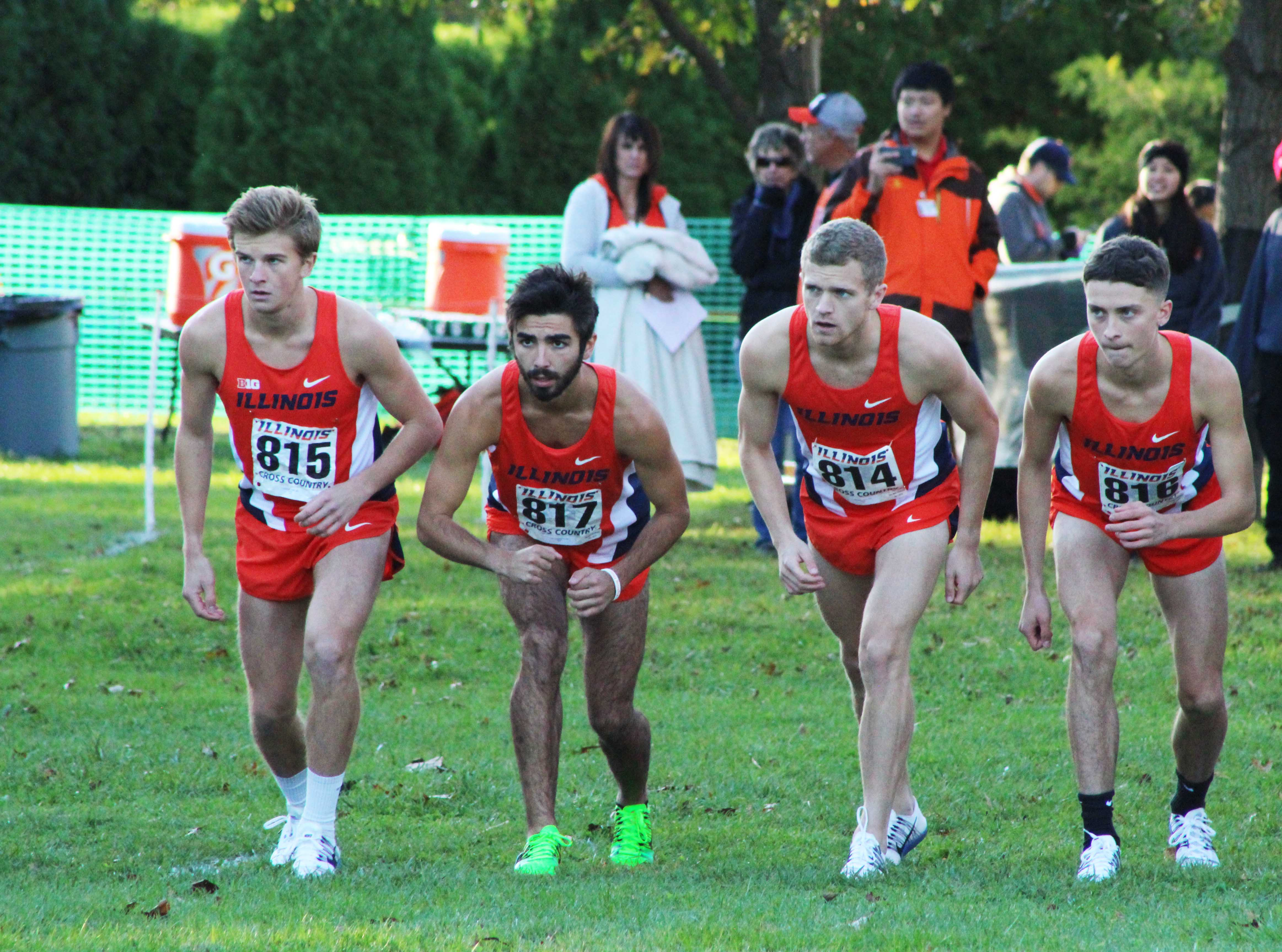 Lining up before the race begins, runners Joe Crowlin, Garrett Lee, Luke Brahm, and Caleb Hummer stand ready to run the Illini Open at the Arboretum on Oct. 21, 2016.