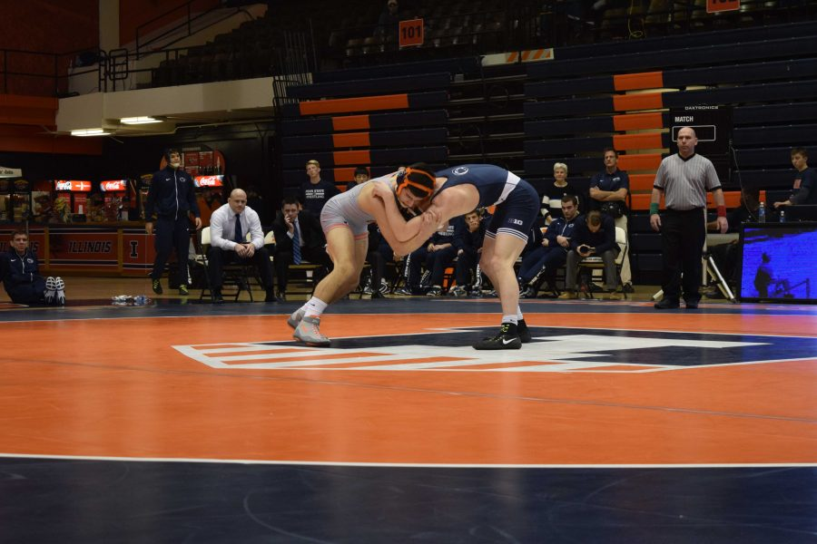 Illinois' Isaiah Martinez getting a hold over Penn State's Jason Nolf during the wrestling match vs. Penn State at Huff Hall on Saturday January 23, 2016.