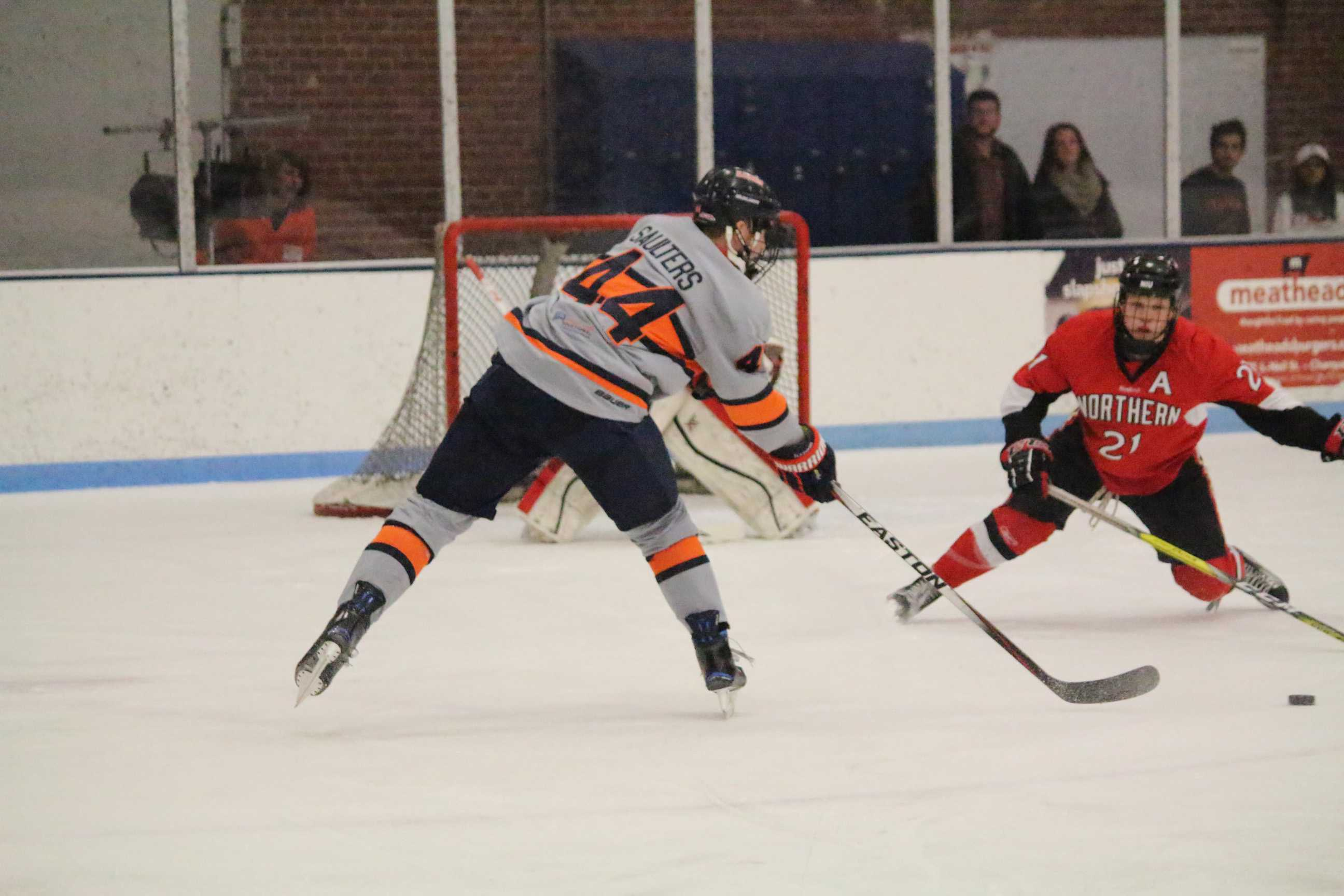 Eric Saulters (44) reaches for the puck to try and score against Northern Illinois at the Ice Arena on Friday, Dec. 2, 2016. Illini beat Northern 5-4.