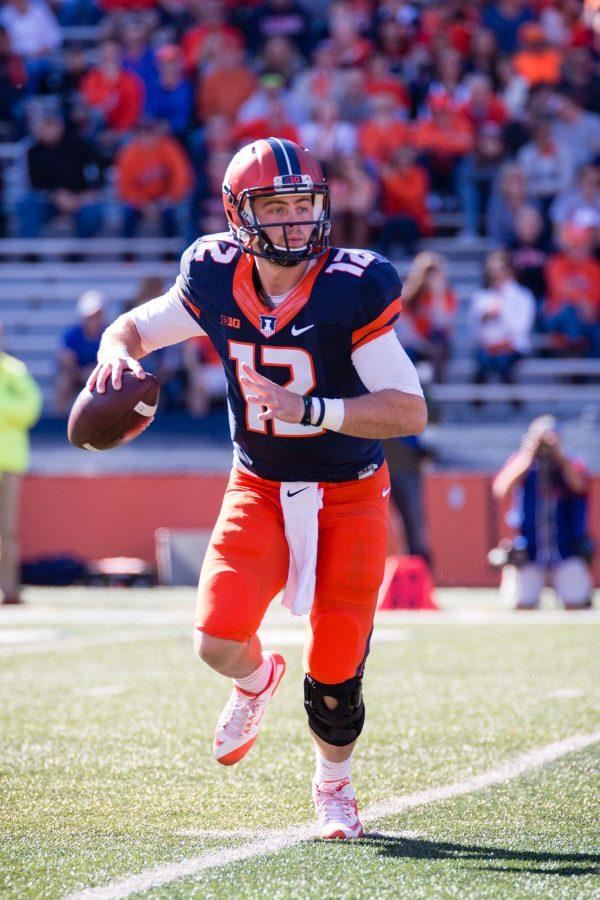 Illinois quarterback Wes Lunt (12) scrambles out of the pocket during the game against Purdue at Memorial Stadium on Saturday, October 8. The Illini lost 34-31.