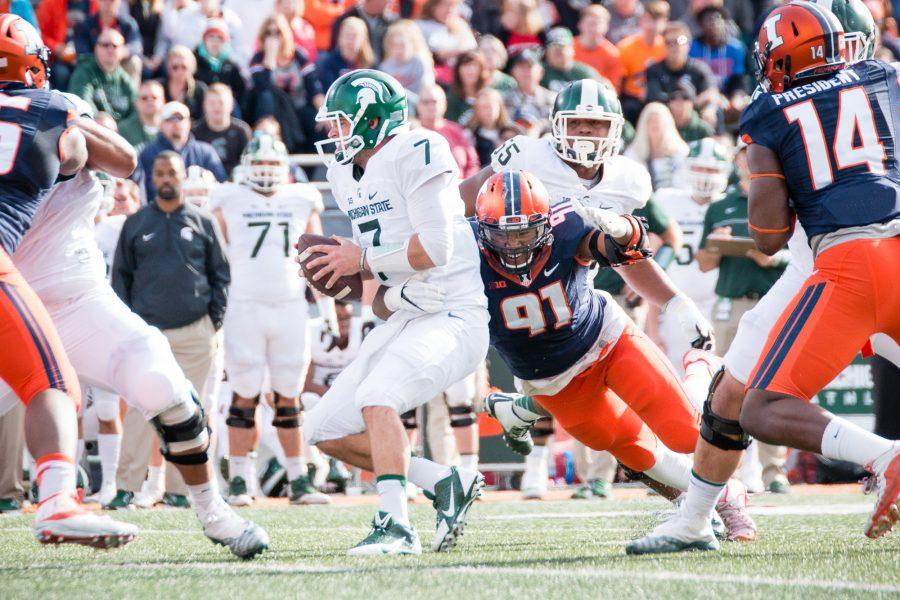 Illinois+defensive+lineman+Dawuane+Smoot+%2891%29+tackles+Michigan+State+quarterback+Tyler+O%27Connor+%287%29+during+the+first+half+of+game+against+Michigan+State+at+Memorial+Stadium+on+Saturday%2C+November+5.+The+Illini+won+31-27.