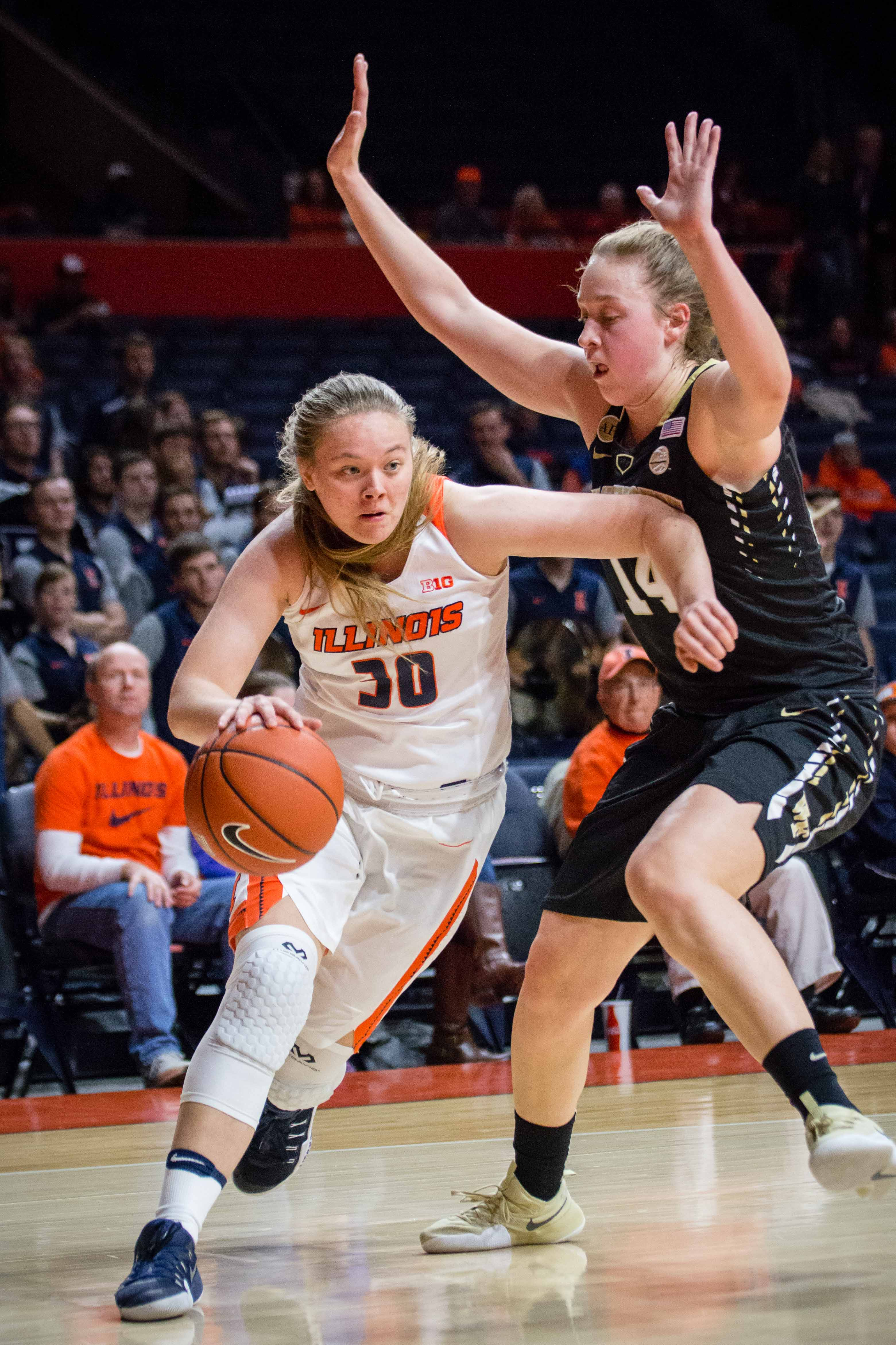 Illinois' Courtney Joens (30) drives to the basket during the game against Wake Forest at State Farm Center on Wednesday, November 30. The Illini lost 79-70.