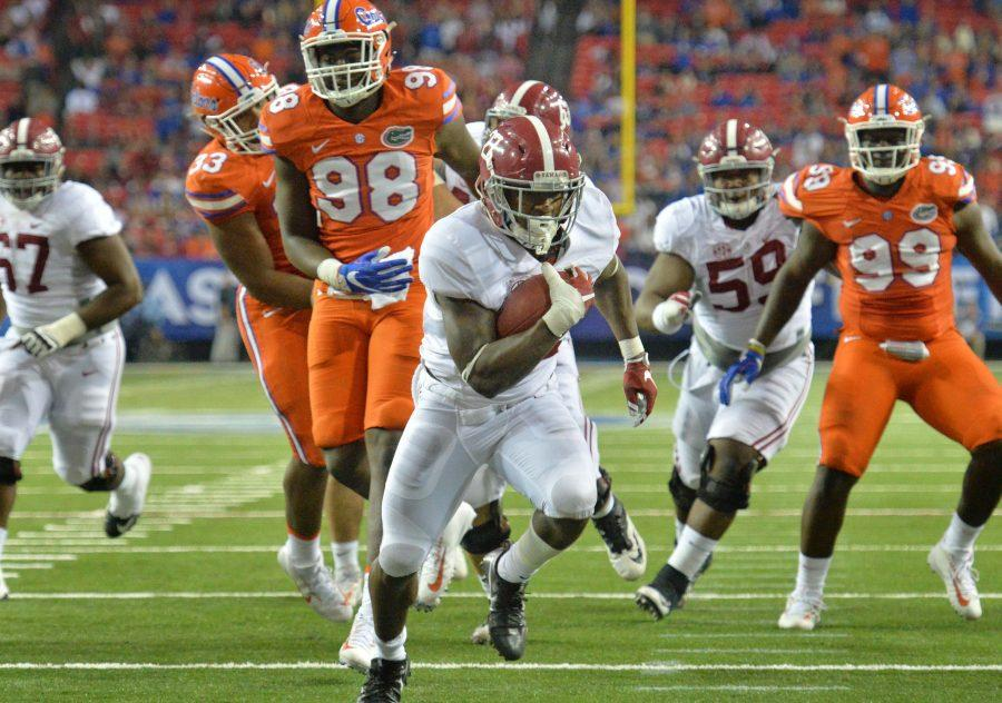 Alabama running back Derrick Gore runs for a touchdown in the second half against  Florida during the Southeastern Conference championship game at the Georgia Dome in Atlanta on Saturday. Alabama won, gaining a spot in the College Football Playoff.