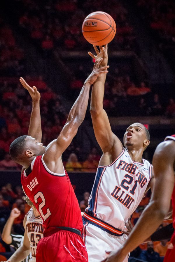 Illinois' Malcolm Hill (21) gets fouled on a floater during the game against North Carolina State at State Farm Center on Tuesday, November 29. The Illini won 88-74.