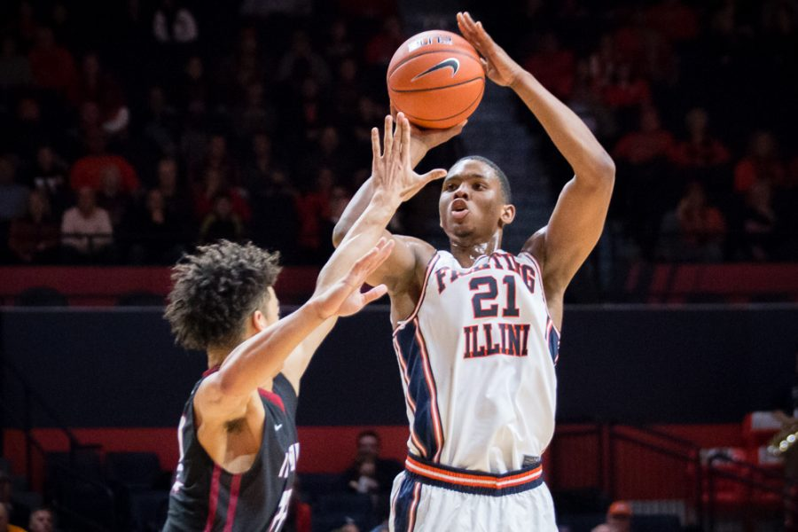Illinois' Malcolm Hill (21) shoots a three during the game against IUPUI at State Farm Center on Tuesday, December 6. The Illini won 85-77.