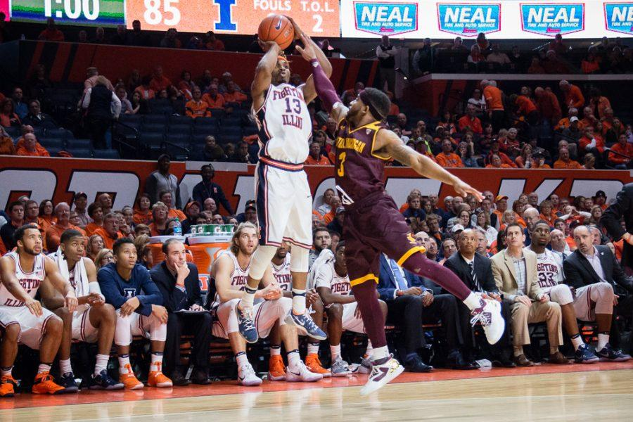Illinois' Tracy Abrams (13) shoots a three during the game against Central Michigan at State Farm Center on Saturday, December 10. The Illini won 92-73.