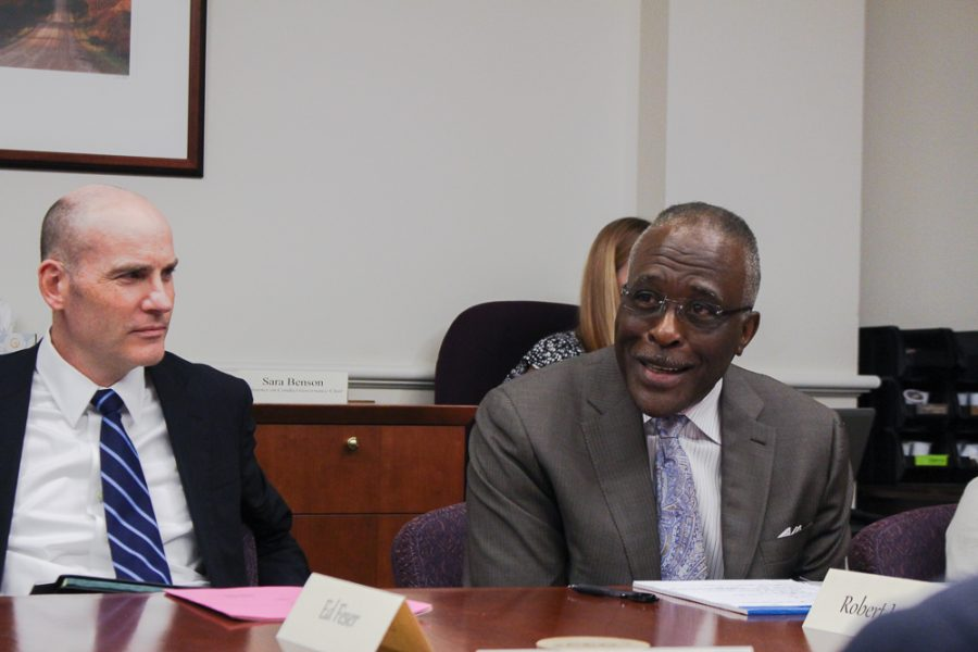 Chancellor Robert Jones and Interim Provost Edward Feser sit in a Senate Executive Committee meeting.