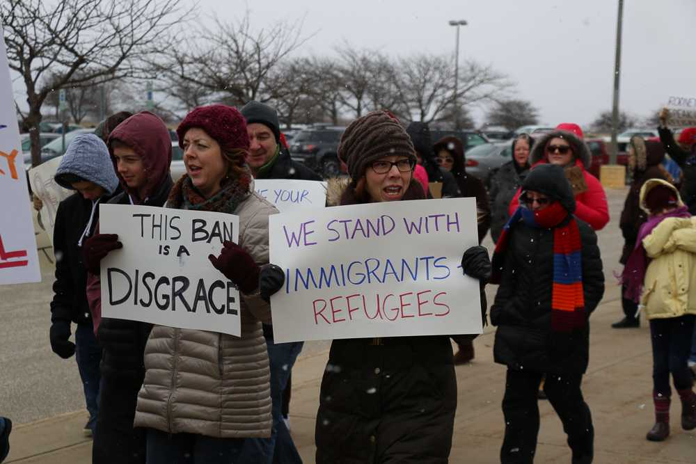 Women at Willard Airport on Sunday protest President Donald Trump's executive order to ban citizens of seven Muslim-majority countries from the U.S.