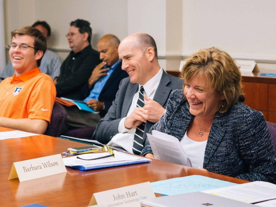 Interim Vice Chancellor Edward Feser and Interim Chancellor Barbara Wilson find that they are able to laugh with the SEC during the discussion of serious matters. Urbana, IL on Monday, April 25.
