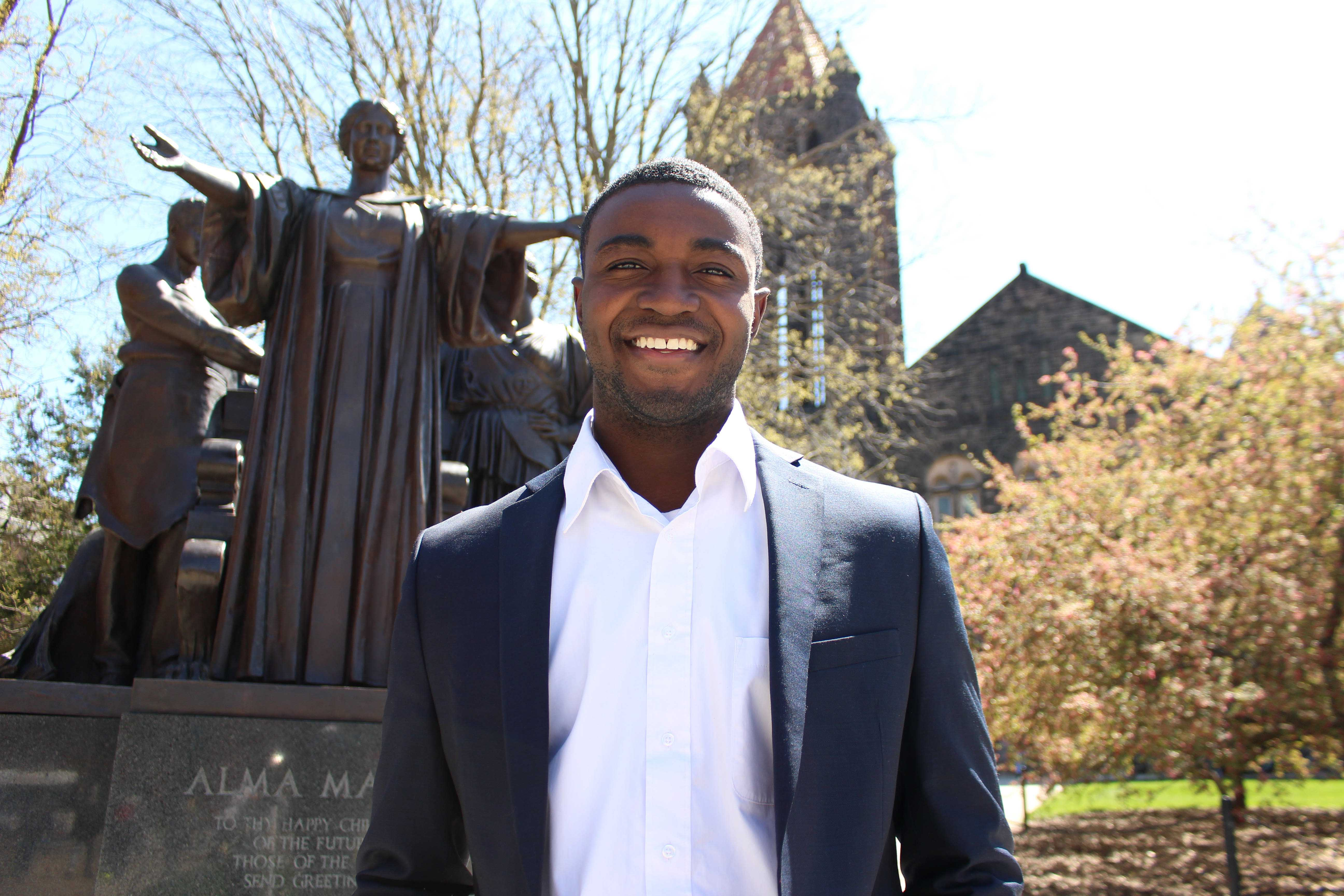 Newly elected student body president Ron Lewis in front of the Alma Mater on Wednesday, Apr. 13