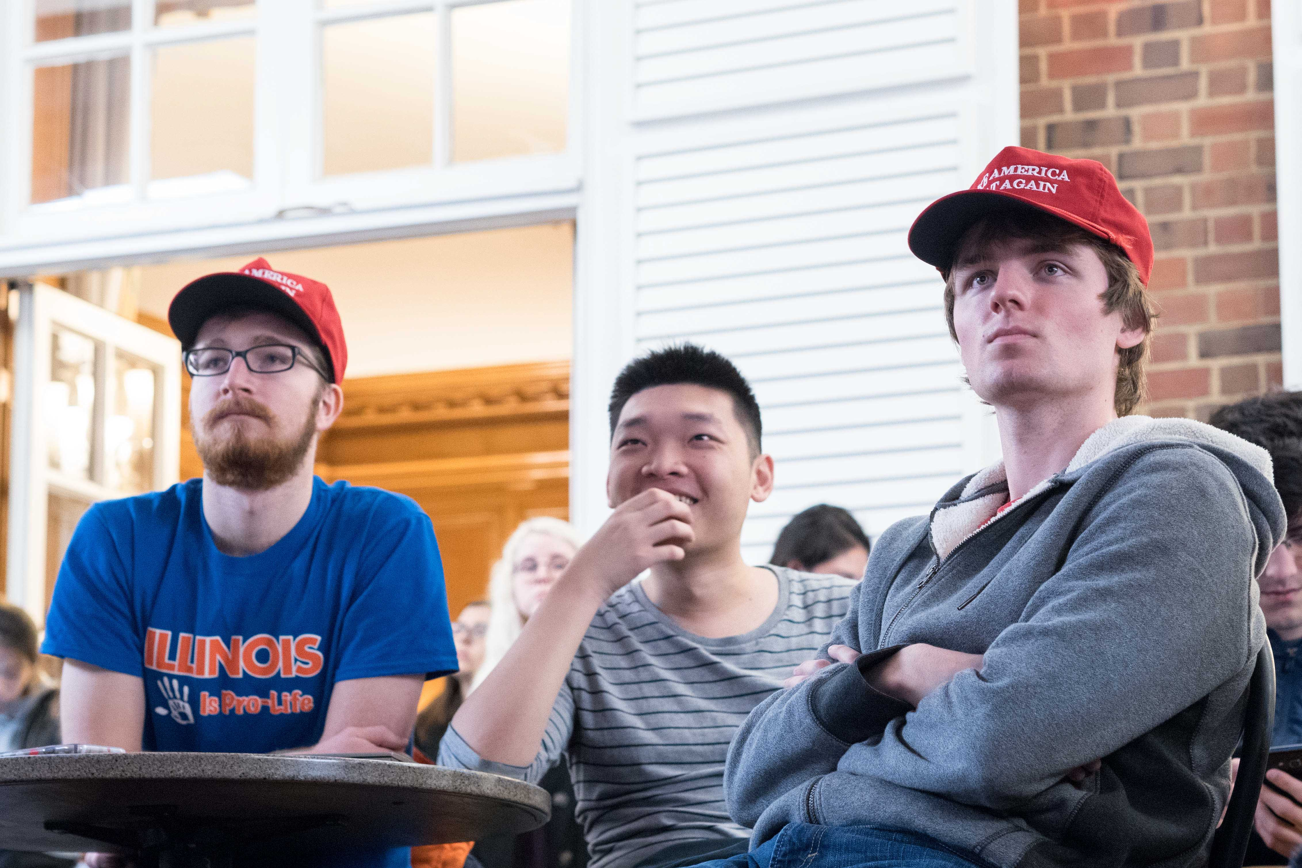 Trump supporters gather in the Courtyard Cafe at the Illini Union to watch the inauguration of the 45th President of the United States, Donald Trump. Columnist Isabella Winkler believes it is crucial to stay critical of the nation's leaders.