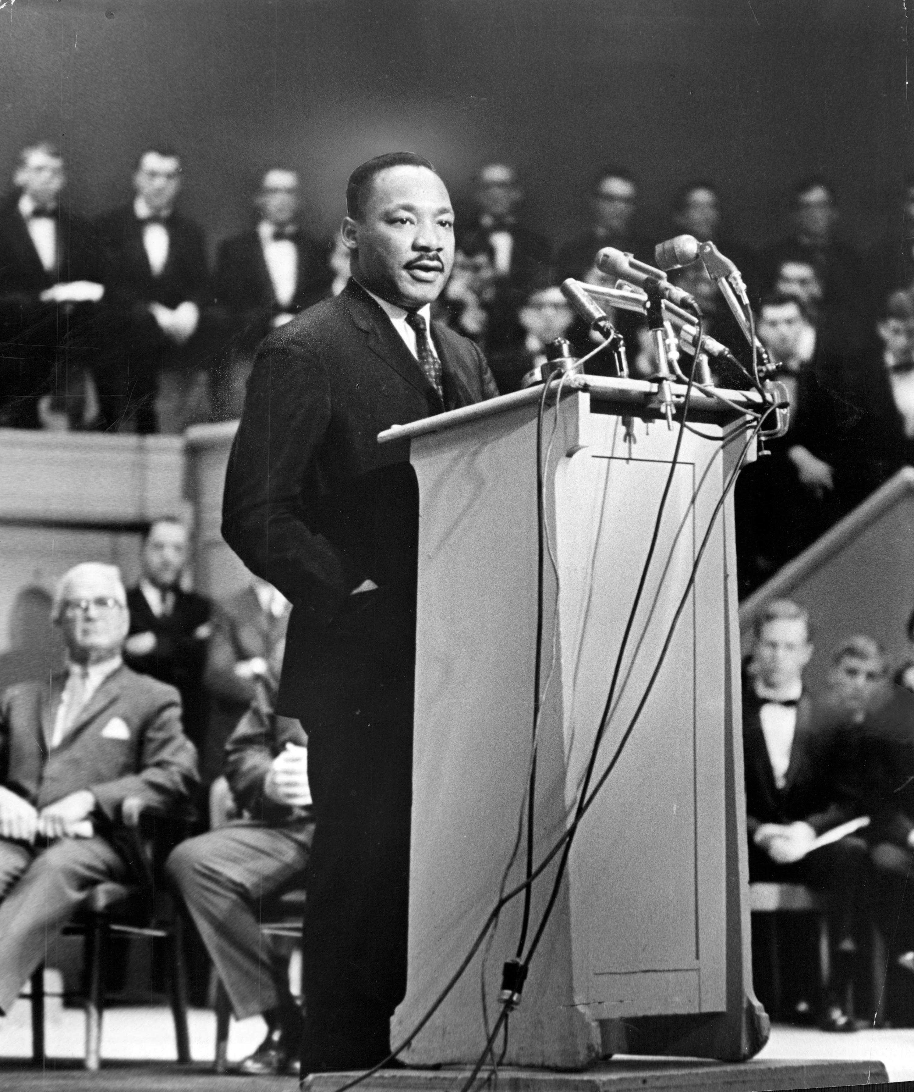 "Dr. Martin Luther King, Jr. addresses the Sunday Evening Club at Orchestra Hall in Chicago on March 14, 1965. King told a capacity audience that ""white and black men alike must learn to live together or they will perish together as fools."" (Jack Dykinga/Chicago Tribune/TNS)"