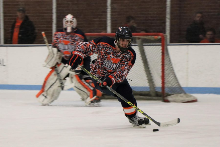 Illinois Mark Candotti handles the puck during the game against Indiana University on Saturday.