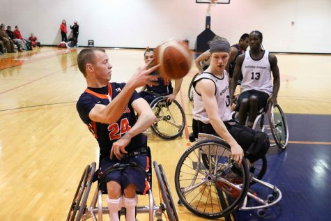 Illinois' Spencer Heslop passes the ball in the tournament against Canadian Academy on Saturday at the ARC.