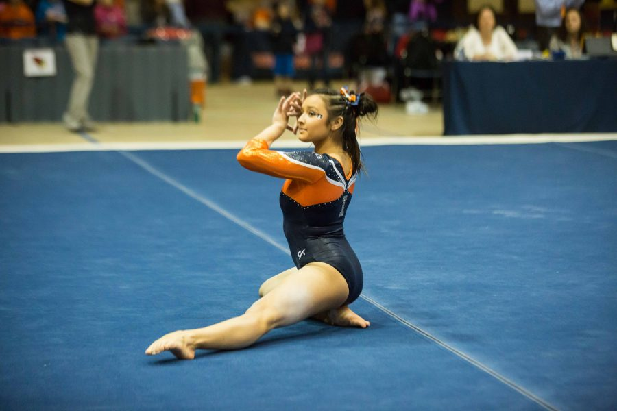 Illinois' Lizzy LeDuc performs a routine on the floor during the State of Illinois Classic at Huff Hall on Saturday, March 5, 2015. The Illini claimed victory for the ninth consecutive year with a total of 195.425 over Northern Illinois (194.225), UIC(192.625) and Illinois State (191.500).