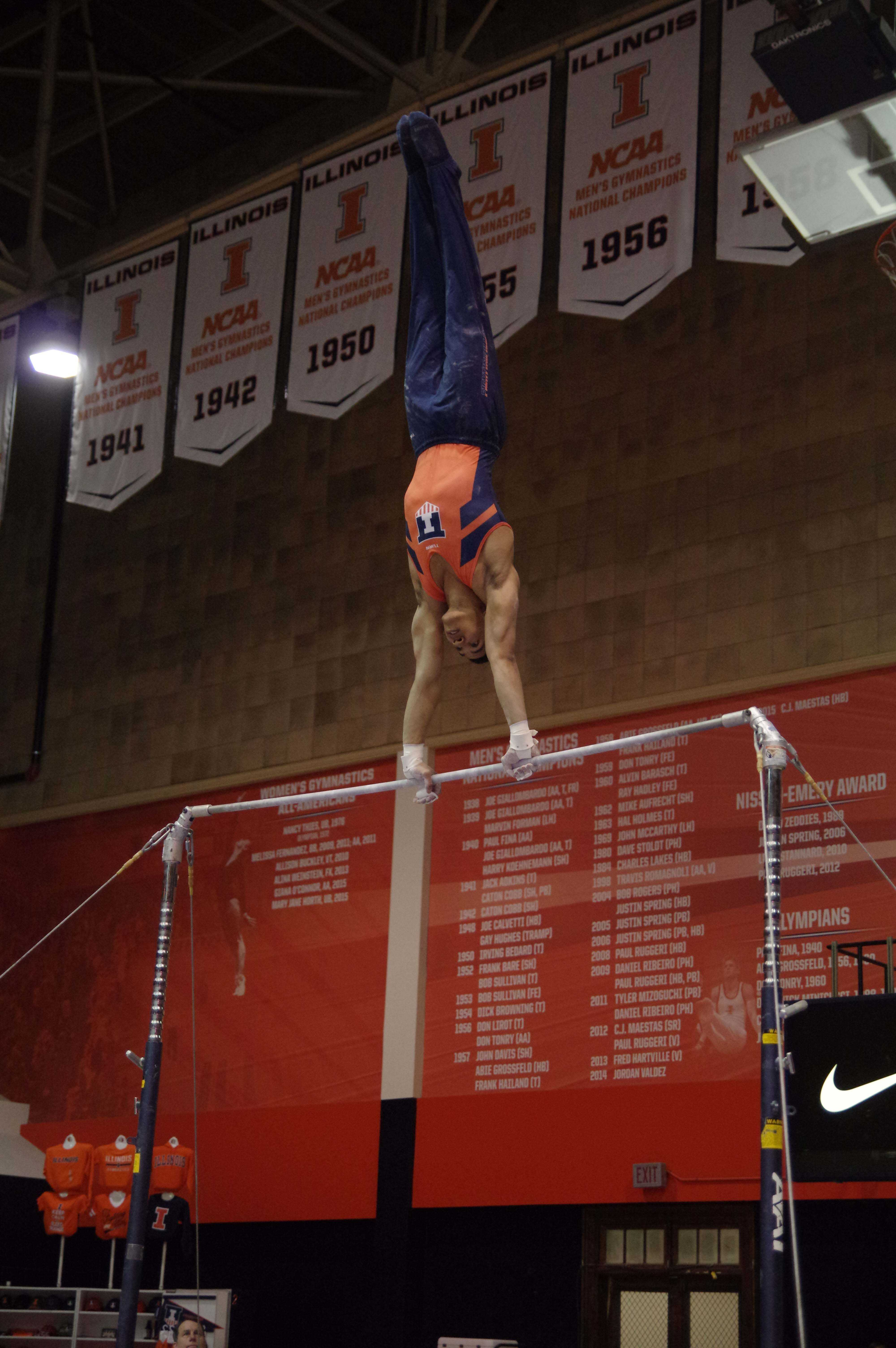 Illinois' Chandler Eggleston performs his routine at the meet against Michigan on March 12, 2016.